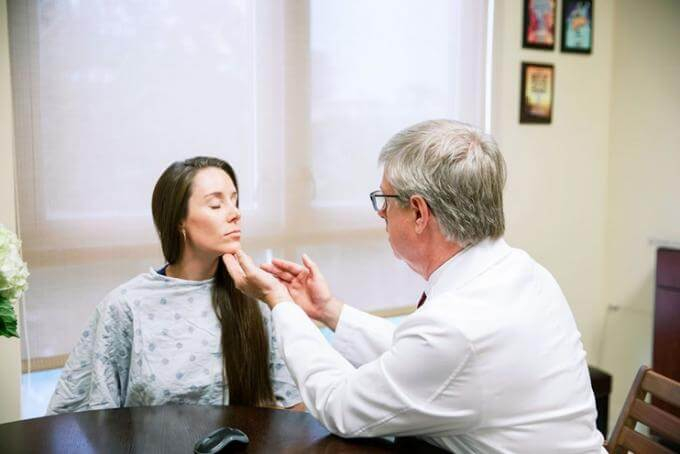 Dr. O'Neill meeting with a patient